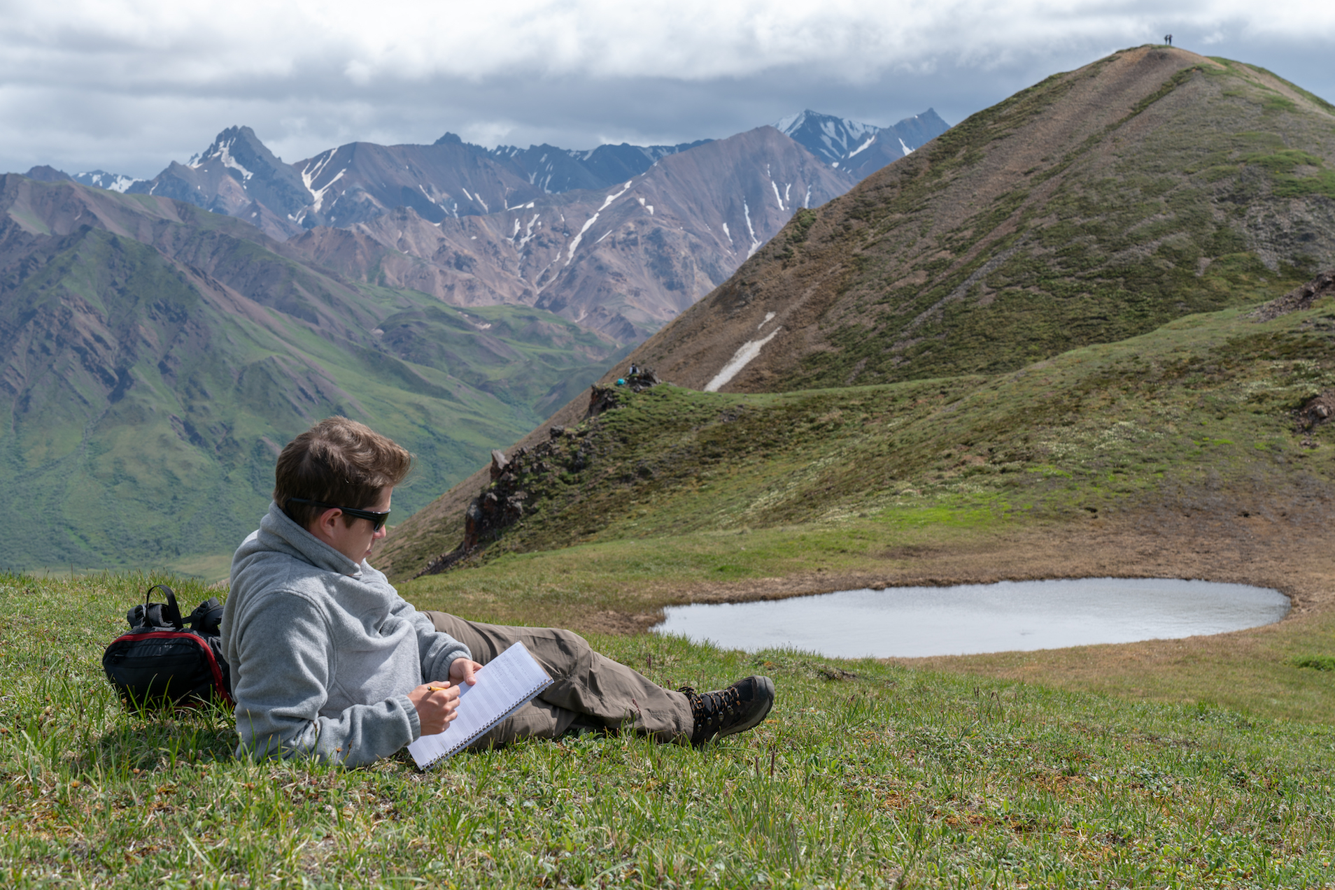 Composer Sasha Avanov drinks in the inspiration on the south side of Cathedral Mountain in Denali National Park (2018)