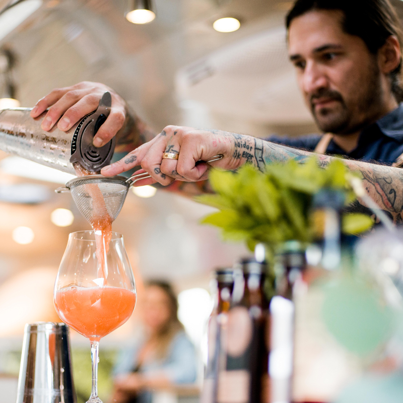Lalo straining a cocktail