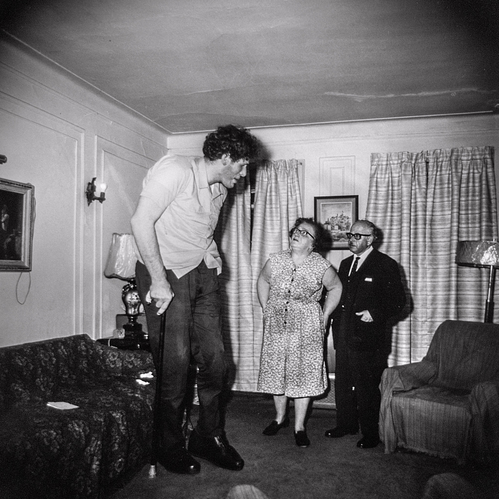 "©1968 estate of Diane Arbus, LLC, A Jewish giant at home with his parents, in the Bronx, N.Y., 1970.   ""Take pictures of what you fear."" - Diane Arbus"