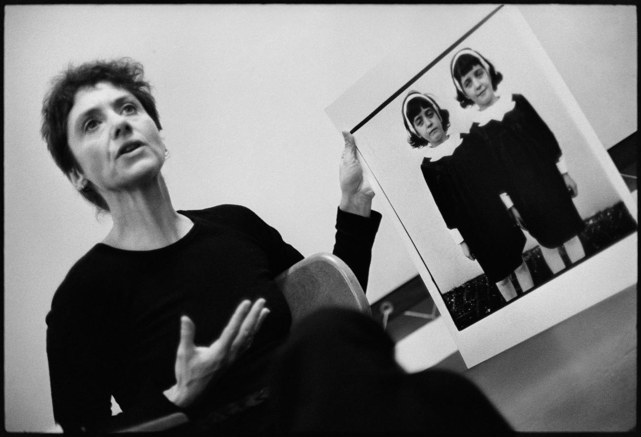 Diane Arbus with her photograph Identical twins, Roselle, N.J. 1966, during a lecture at the Rhode Island School of Design in 1970. © Stephen A. Frank