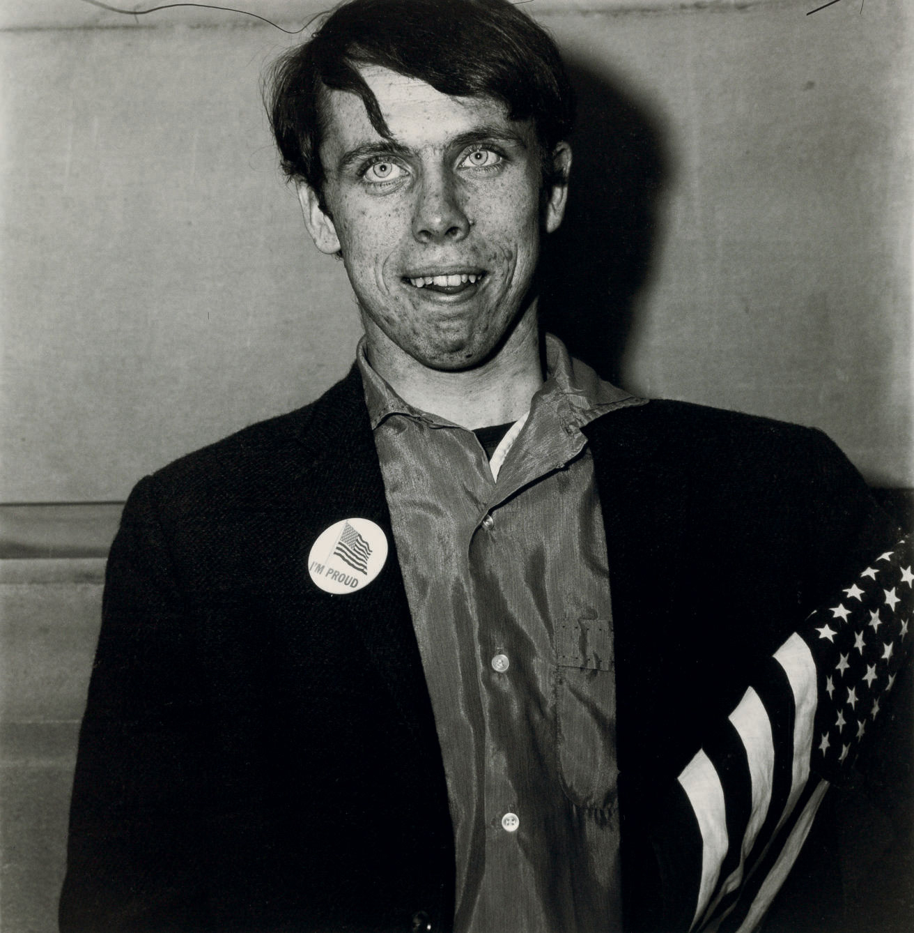 "©1968 estate of Diane Arbus, LLC, Patriotic Young Man with a Flag, N.Y.C. 1967   ""What I'm trying to describe is that it's impossible to get out of your skin into somebody else's…. That somebody else's tragedy is not the same as your own."" - Diane Arbus"