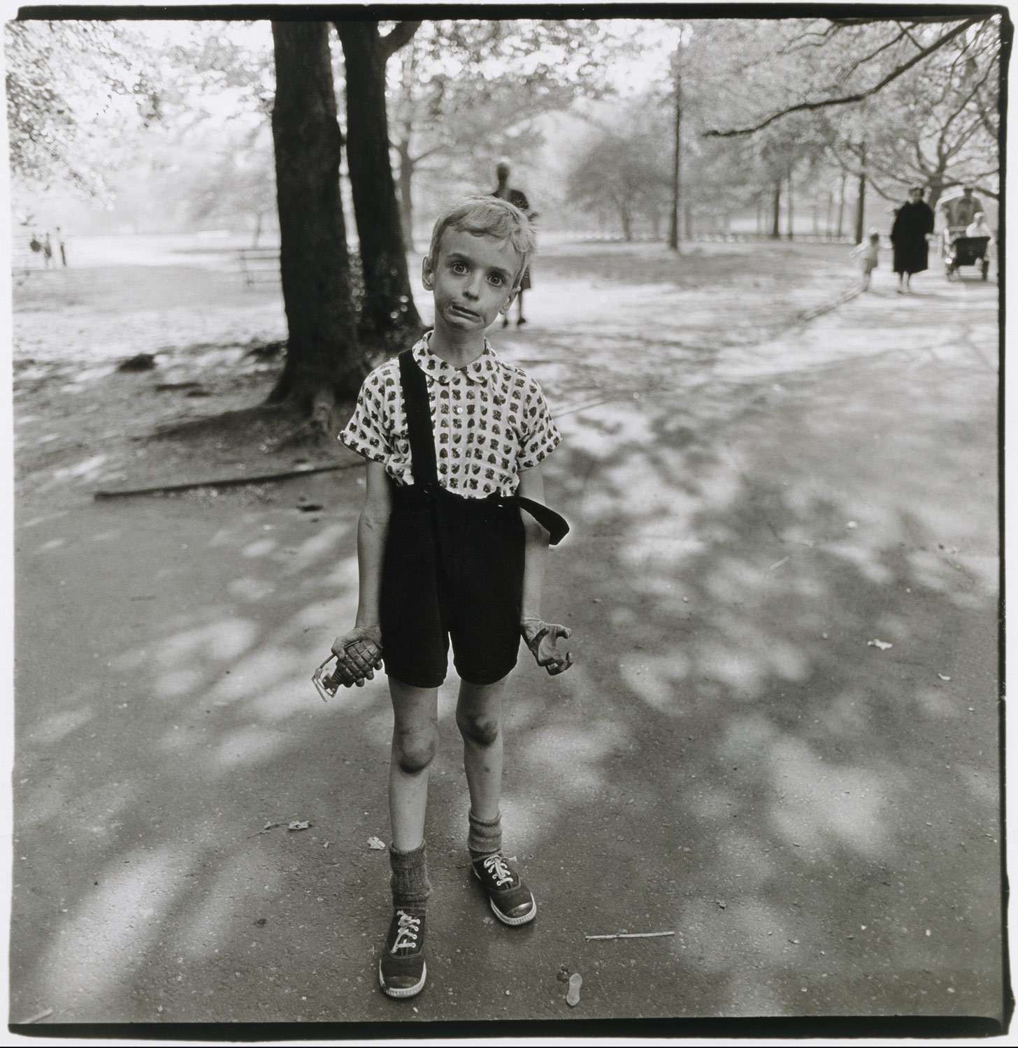 "©1968 estate of Diane Arbus, LLC, Child with a toy hand grenade in Central Park, N.Y.C. 1962   ""There's a quality of legend about freaks. Like a person in a fairy tale who stops you and demands that you answer a riddle. Most people go through life dreading they'll have a traumatic experience. Freaks were born with their trauma. They've already passed their test in life. They're aristocrats."" -Diane Arbus"