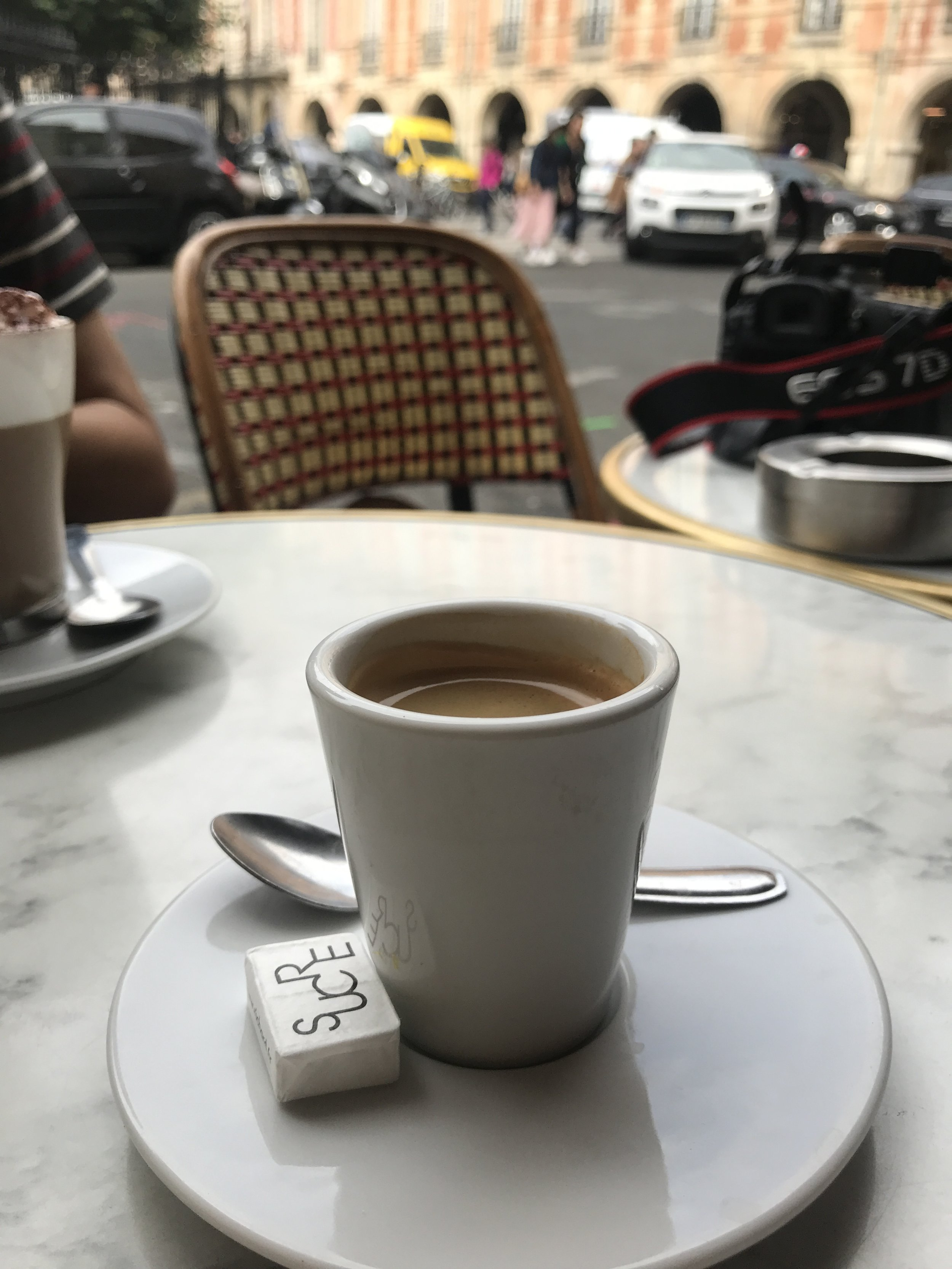 Enjoying an espresso across from Place de Vosges. Pro Tip - pack juice-box sized soy/almond/oat/cashew milks in your checked luggage to keep on hand. I put a splash into all my espresso drinks when needed.