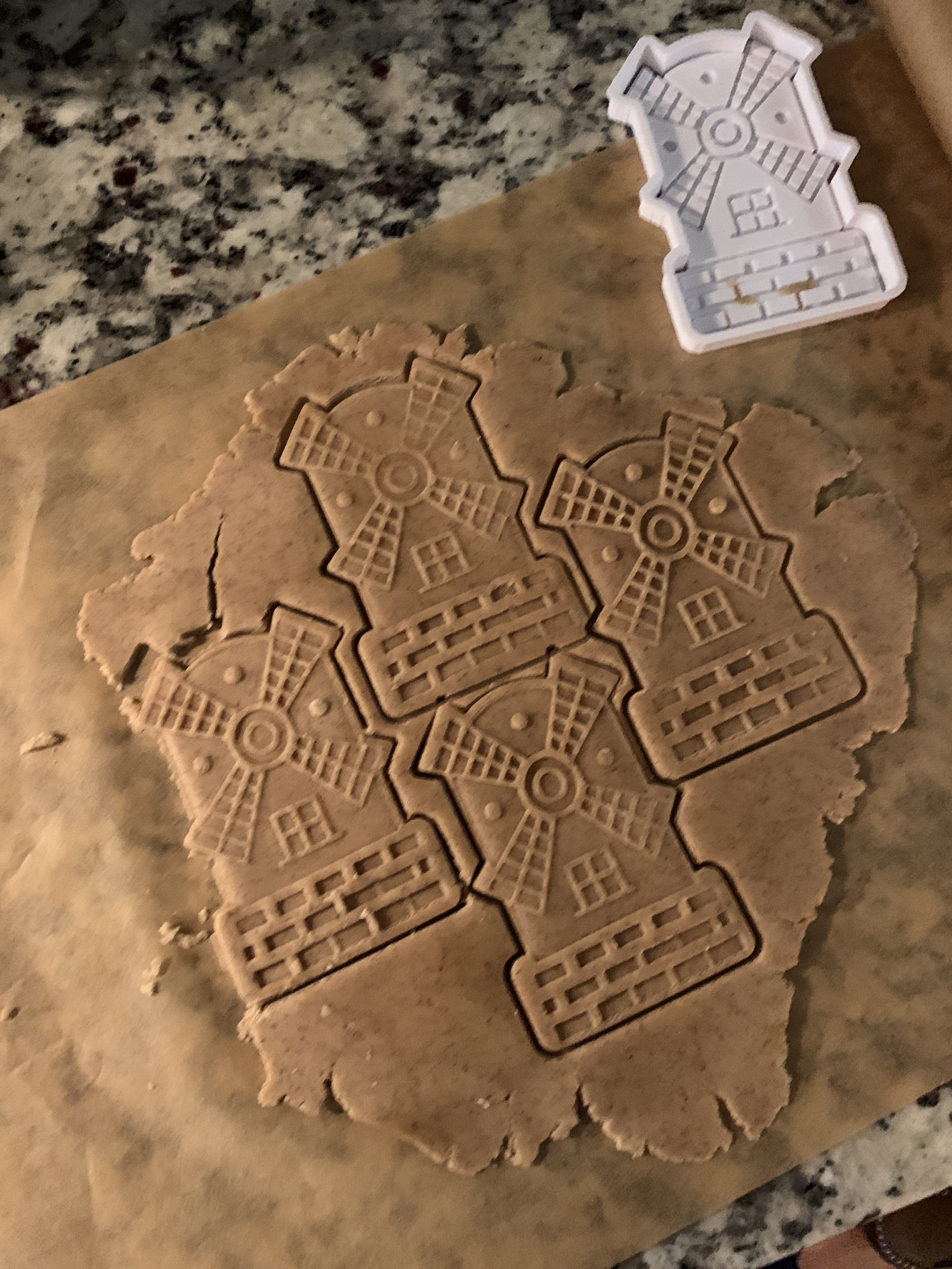 Pro tip - Dust the cookie stamp with a bit of flour to prevent the dough from sticking.