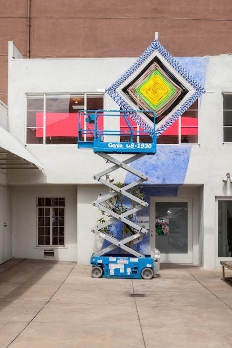 Jessica Stockholder, Lift Series, 2013, Chalk, acrylic paint, scissor lift, godseye, dimensions variable