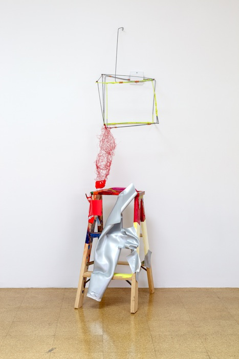 Jessica Stockholder, A Red Flow, 2013, Step ladder, paper, plastic clamp, red wire, red yarn, carpet wire, copper clamps, silver vinyl, plastic parts, hardware, acrylic paint, 83.5 x 22 x 32 inches