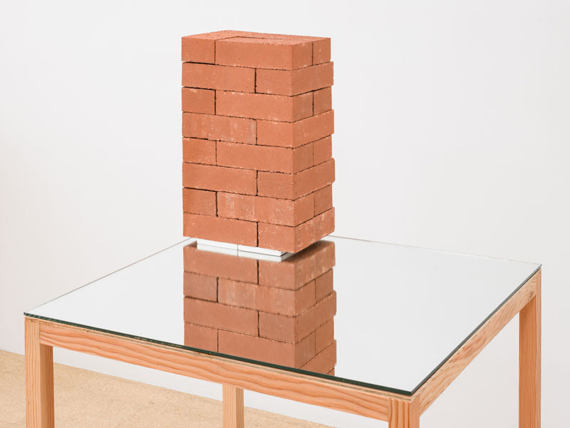 Jorge Mendez Blake, The Camus Monument, 2012, bricks, book, mirror, wood, 52.625 x 31.5 x 29.5 inches