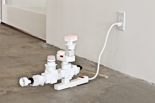 Philippe Parreno, AC/DC Snake, 2010, Electric outlet adapters