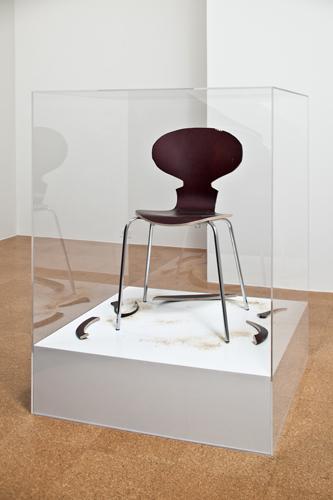 SUPERFLEX, Copy Right, 2007, Wood chair, sawdust, cut-outs, wood platform, plexi-glass box, 35 x 35 x 47 in., Edition 1 of 5