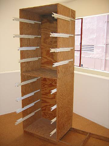 Jorge Pardo, Facing the Finish, 1991, Plywood, metal sliders, 84 x 36 x 36 in.