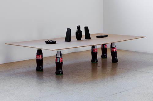 Sriwhana Spong, Rattle, 2008, Masonite, lac, black pigment, Coke bottles