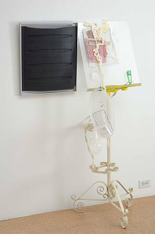 Jessica Stockholder, Untitled, 2007, Aluminum frame, various plastic parts, plexi-glass, carpet, yarn, acrylic, oil and enamel paint and metal stand, 57 x 35 x 21 1/2 in.
