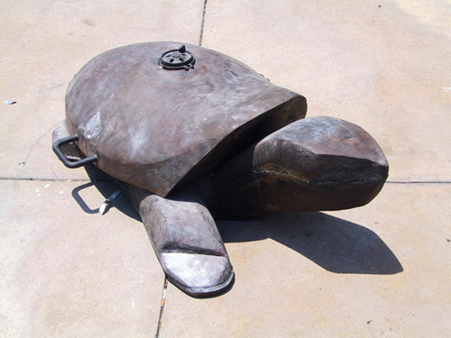 Pae White, Briquettes and Support: Turtle, 2003, Cast iron, 40 x 6 x 6 in.