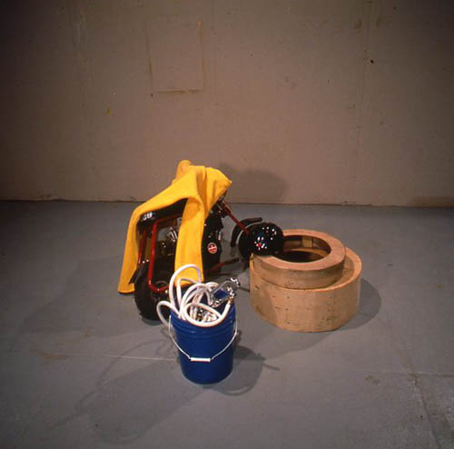 Jason Rhoades and Jorge Pardo, Ranch, 1996, Mixed media with leaky faucet and blue bucket