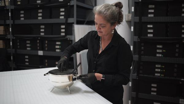 Pae White considering Christopher Dresser's Soup Tureen and Ladle, c. 1877–78, Los Angeles County Museum of Art, Decorative Arts Council Fund