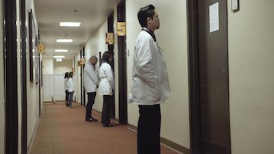 Video still from  Standardized Patient.