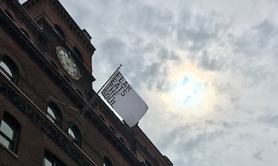Rirkrit Tiravanija,  Untitled (Fear Eats the Soul) (White Flag),  2017, raised at Pratt Institute.