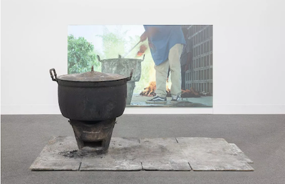 Rirkrit Tiravanija,  Untitled 2014-2015 (curry for the sould of the forgotten),  47-minute video projection, bronze fire pot, size variable.