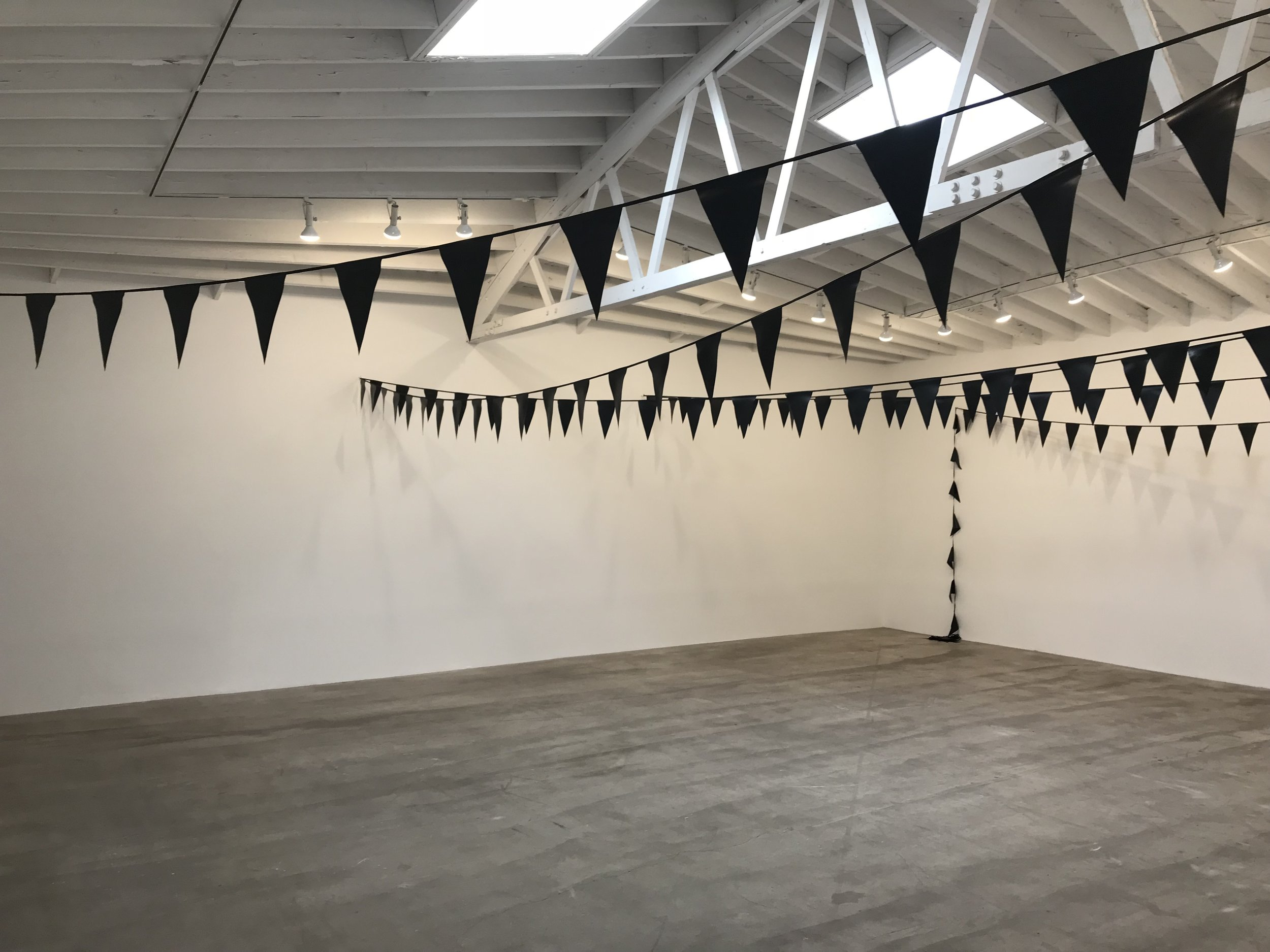 Fiona Banner, Black Bunting, 2001. Installation view UNIT 5.
