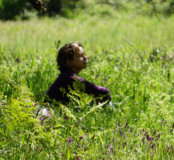 woman in meadow ANFT.png