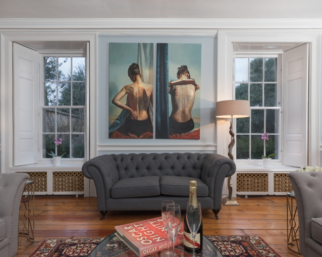 BIZ-LOCATION-art-in-home-woman-back-moody-bedroom.jpg