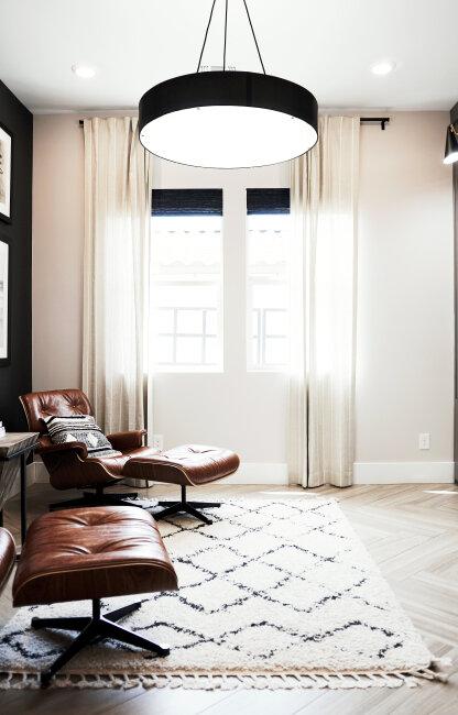 BIZ-LOCATION-warm-patterned-rug-leather-chair-modern-lighting.jpg