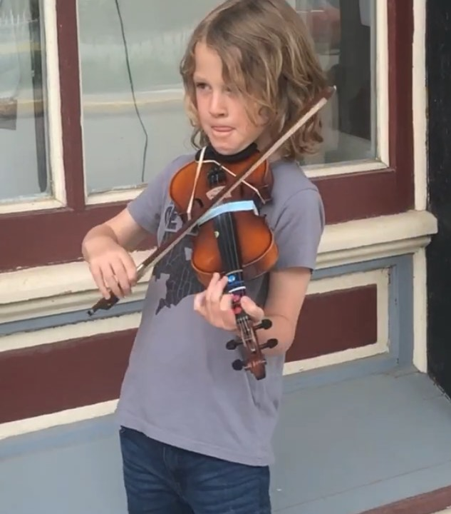 It just doesn't get any sweeter than this.  The cutest little busker EVER!  #stockholmcharm #busker #littlebusker #violin #stockholmwisconsin #visitpepin #discoverwisconsin #travelwisconsin #vacationrental #whitehouseinn