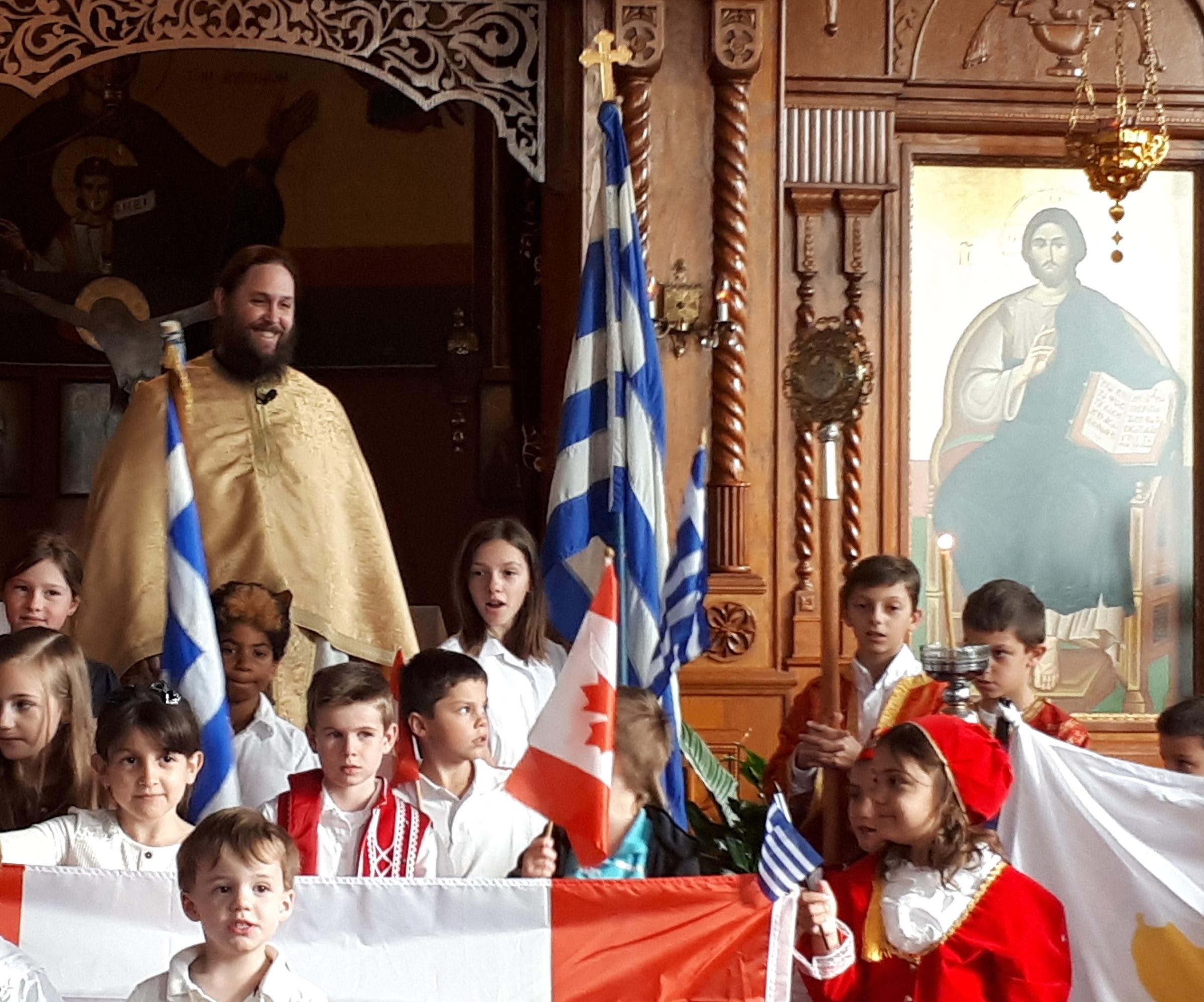 Fr_Matthew_Penney_with_School_Children.jpg