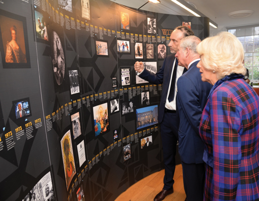 HRH The Prince of Wales and The Duchess of Cornwall with Paul Reid, Black Cultural Archives Director, during their visit in February 2017