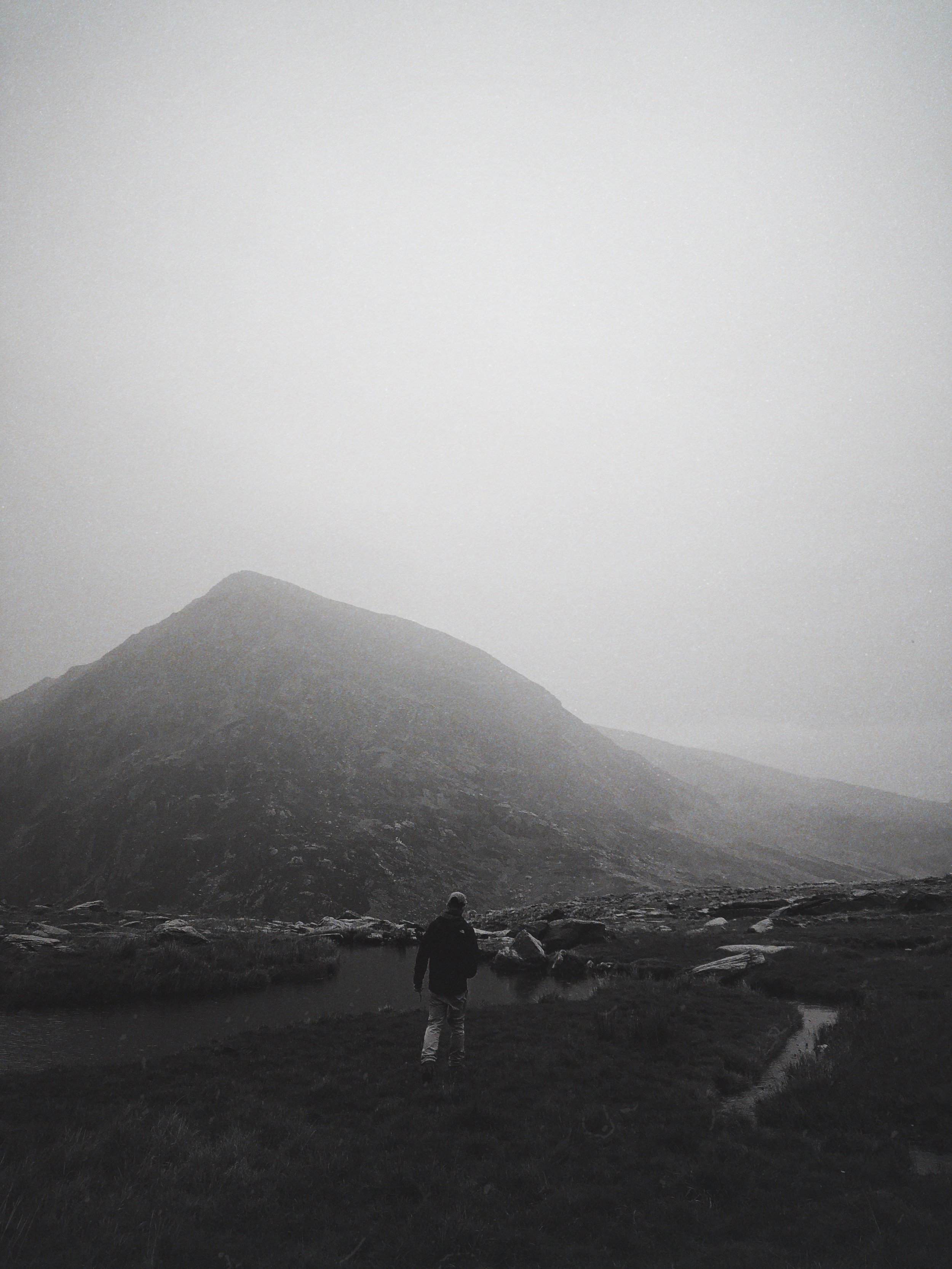 Director Adam surveying the bleak Welsh landscape on a location scout.