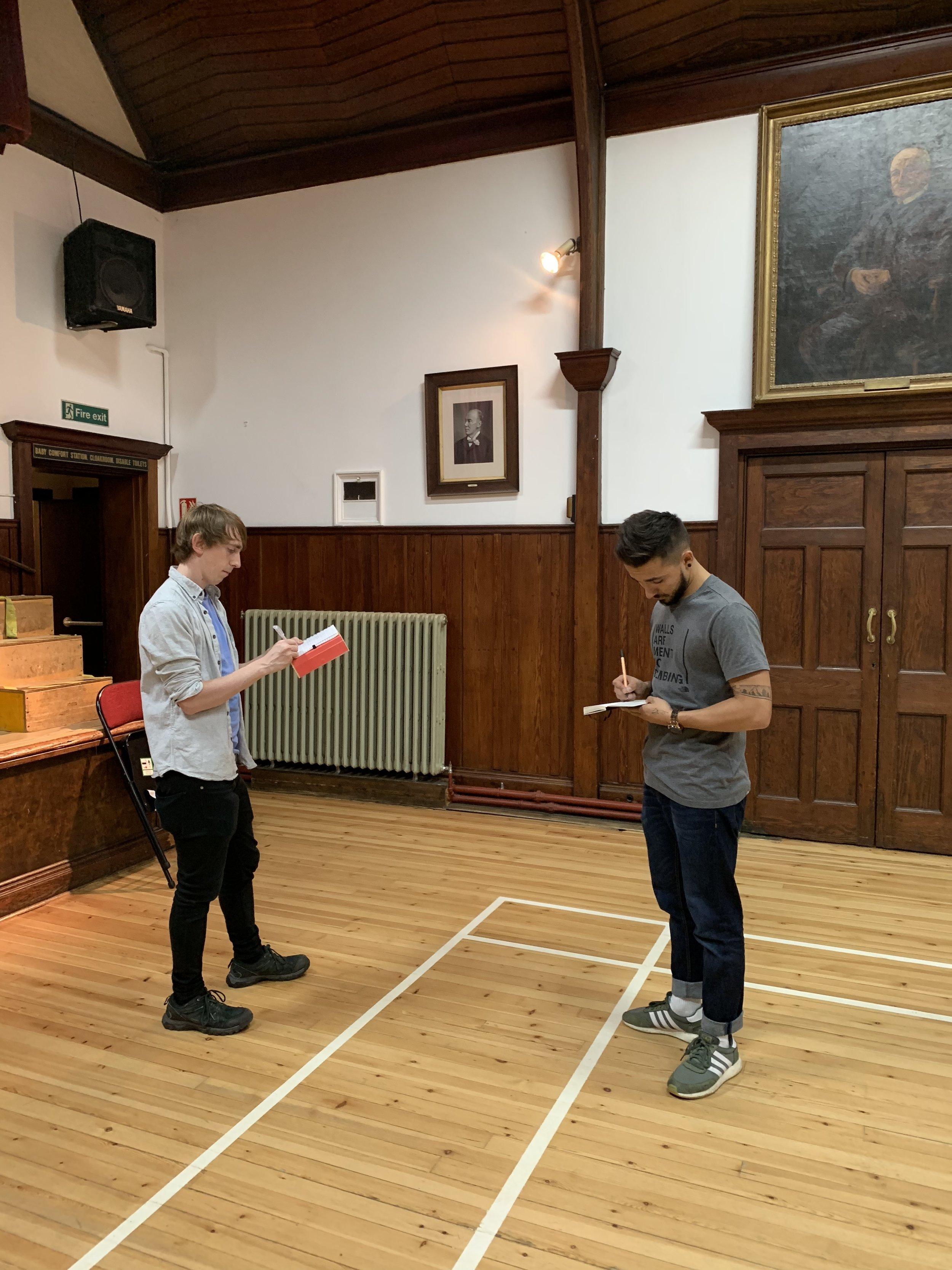 Gaffer Dave Bird & Josh work out a lighting plan.