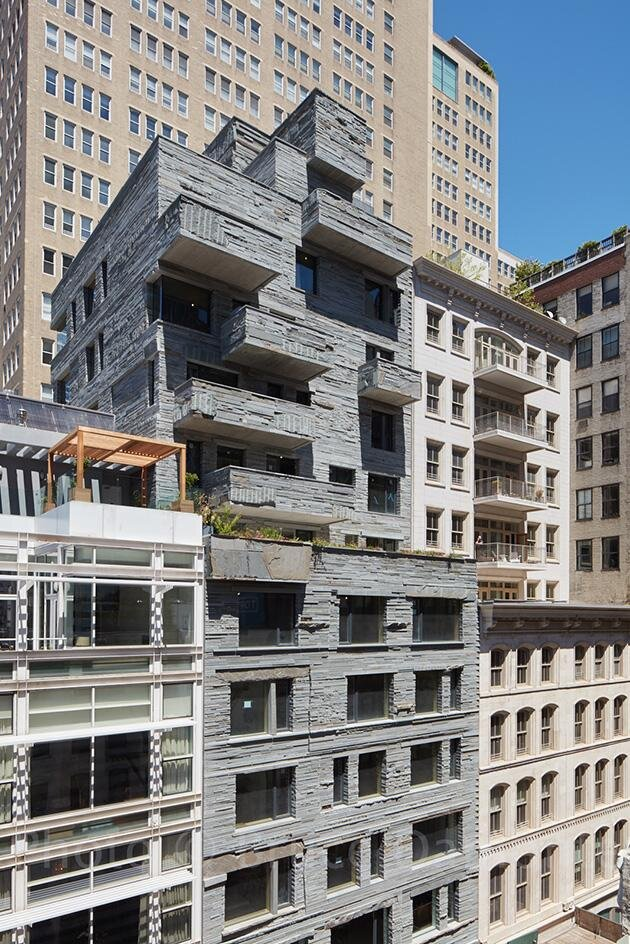 The scheme's bluestone façade is one of its defining, standout features.  Photography: DDG