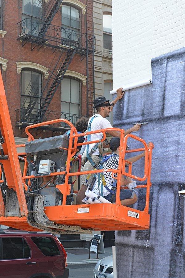 JR installing his art in Tribeca. Photo: courtesy JR.