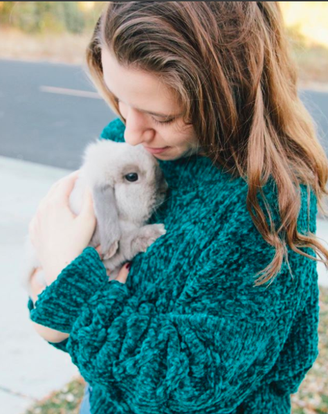 This is Elena with her pet bunny Lucy.