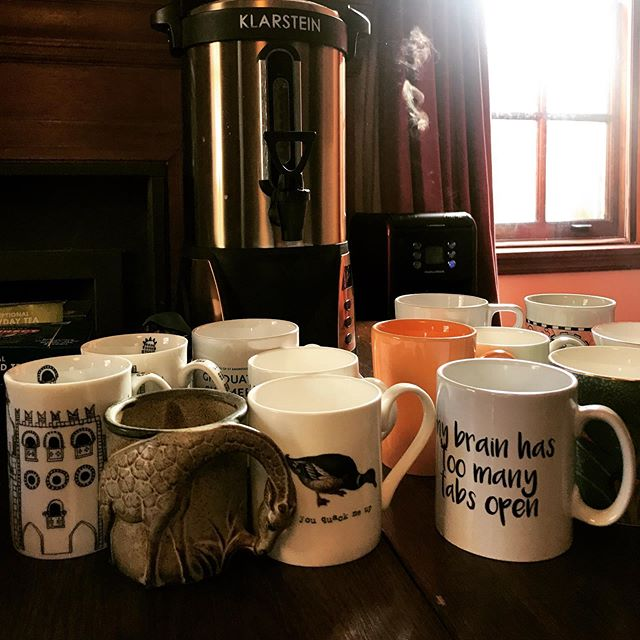 We host Scriptorium at my church's Rectory, which means we have access to an excellent (and somewhat random!) assortment of mugs. I particularly relate to the white mug on the right...