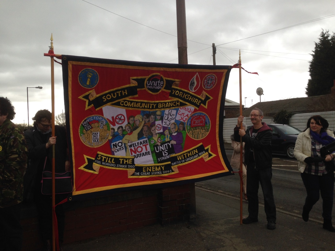 """Stuart Crosthwaite on the right hand side of the picture, holding the South Yorkshire Unite Community banner at the Hatfield Colliery'anniversary march back"""" in March 2015. The pit was closed a few weeks later"""