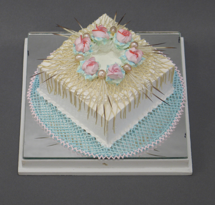 Acrylic square white cake with pink flowers on top