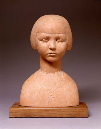 Statue of a terra cotta girl wearing a necklace