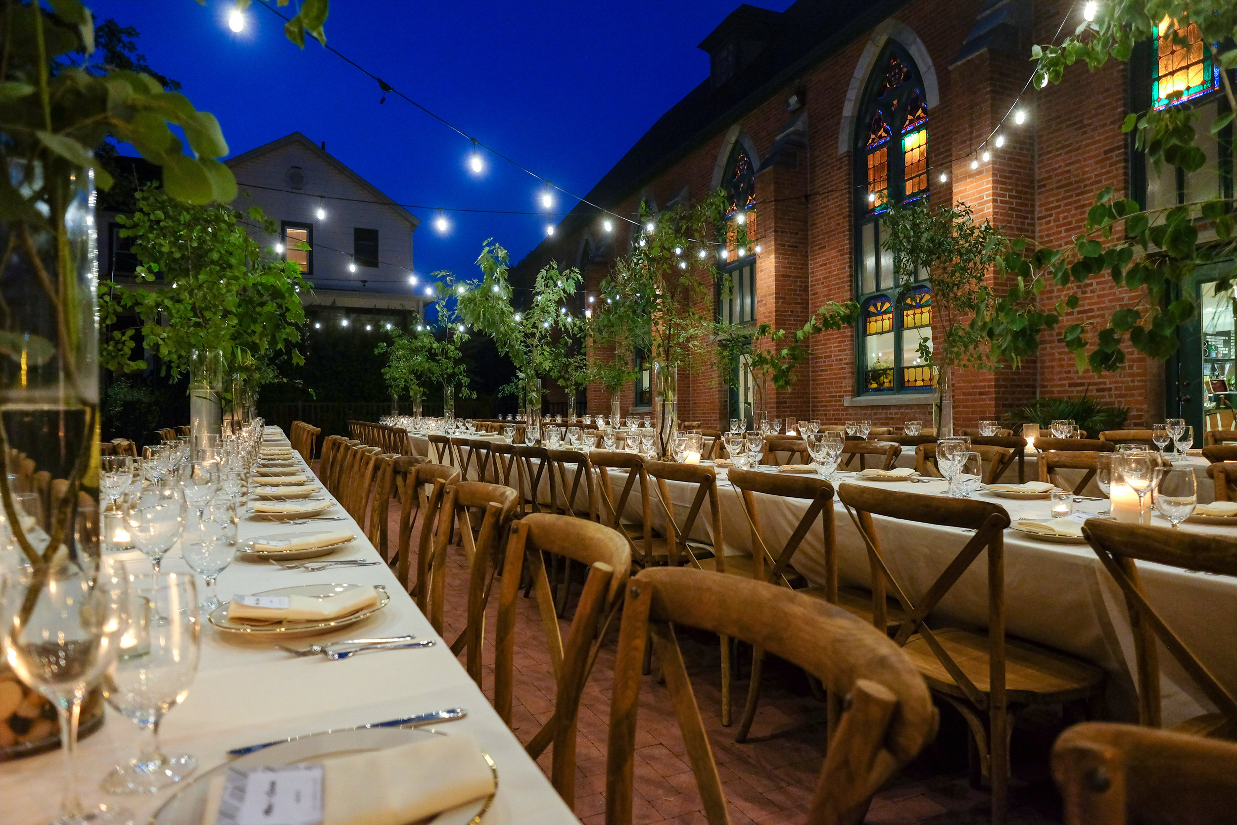 Dine Under the Stars - Wrapping around the building is our outdoor patio that allows for guests to take in the charm of the Village of Tivoli while dining alfresco or sipping cocktails before dinner is served. With room for over 200 guests, the expansive patio can be used in conjunction with The Sanctuary indoors for seated dinners, post ceremony receptions, cocktail hours, and much more. A flexible space with countless layout possibilities.