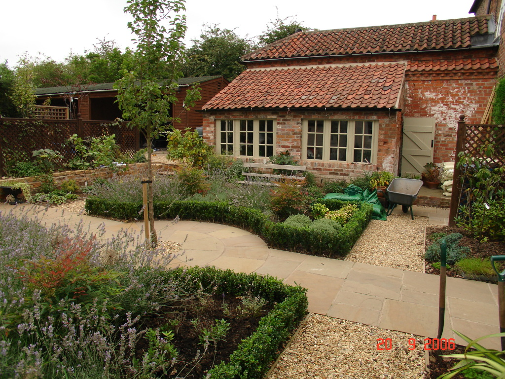 The renovated buildings and formal herb garden