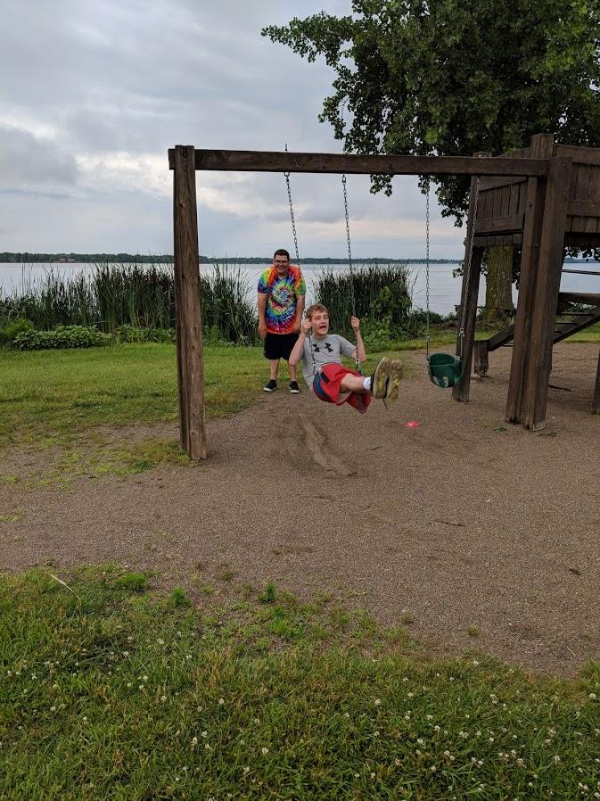 Tyler pushing Jack on the swing.jpg
