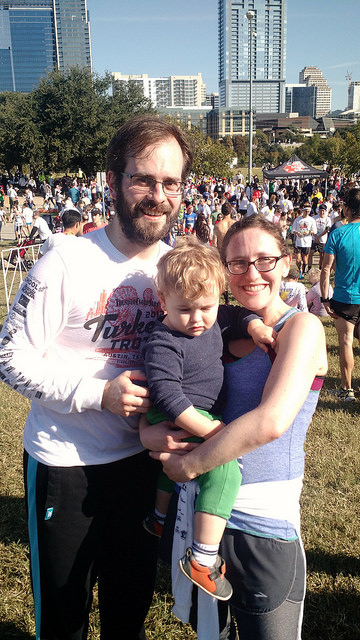 At the 2016 Turkey Trot in downtown Austin. (My kid does not seem into it…)