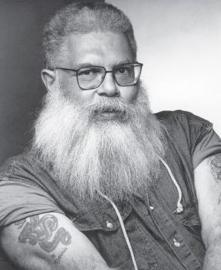 "Delany as queer black SF elder statesman, with his trademark ""Santa Claus"" beard."