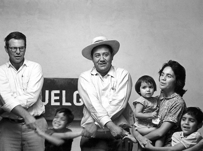 Huerta with children at the United Farm Workers Hall, 1960s.