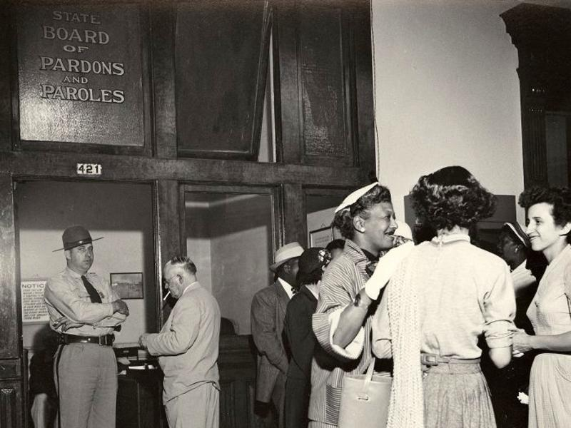 Supporters of Rosa Lee Ingram wait outside during her 1953 parole hearing. Photograph by Norma Holt, from the Schomburg Center for Research in Black Culture, Photographs and Prints Division, New York Public Library.