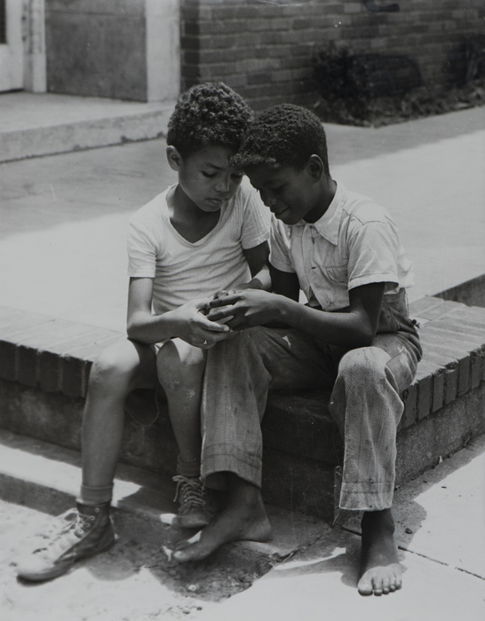 Two young boys at a camp in Dallas, Texas, circa late 1940s/early 1950s. Photograph by Marion Butts.  Via the Texas African American Photography Archive . I decided to post this sweet image instead of its horrific inverse from the same time period: the open-casket photograph of Emmett Till, a 14-year-old boy who was brutally murdered in Mississippi in 1955.  His mother Mabie Till-Mobley insisted on an open casket  to mobilize civil-rights action: another example of a mother's grief, and her rage, being channeled into social change.