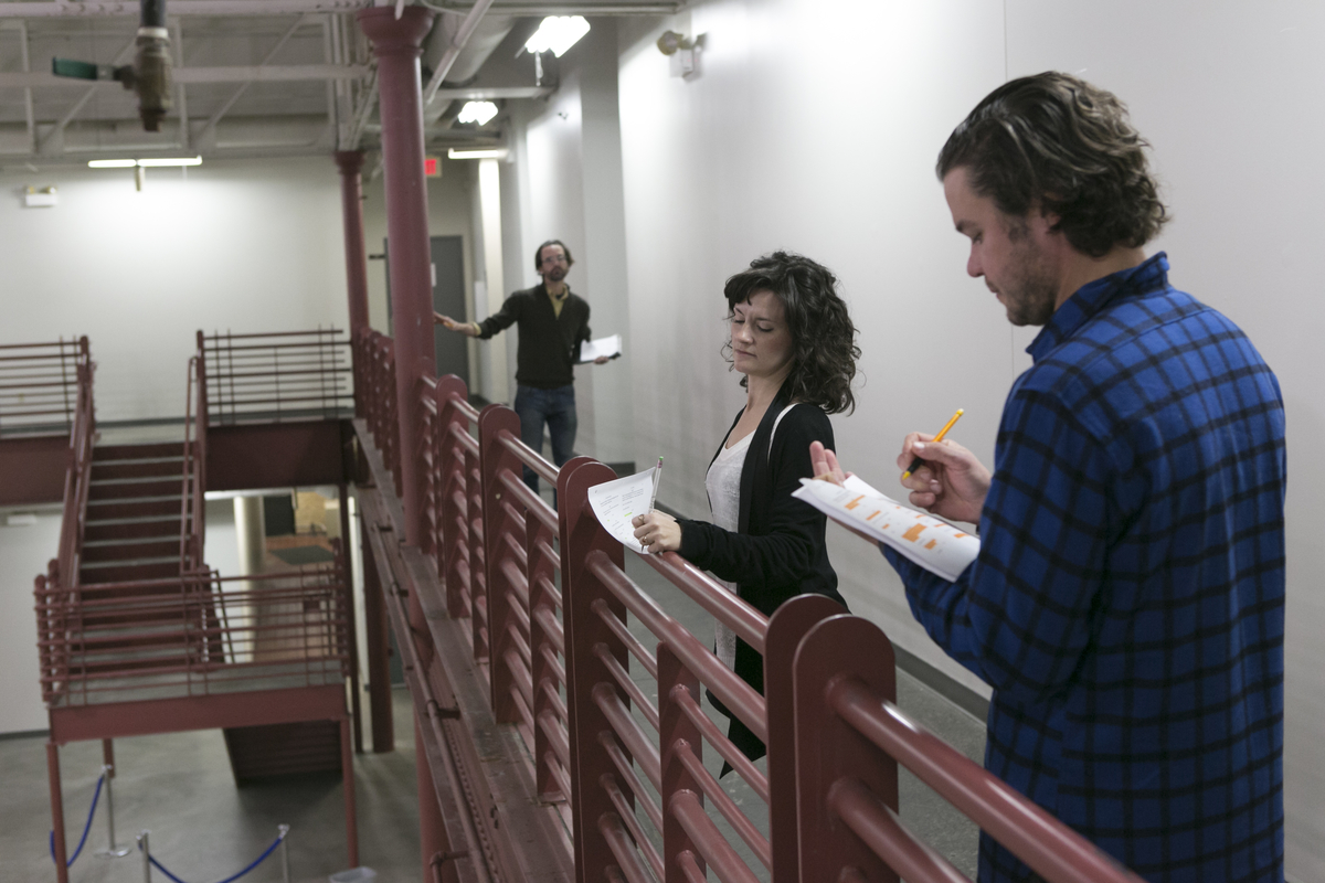Director Benjamin McGovern+ and actors Sara Marsh* and John Catron* rehearse  The Hothouse  by Harold Pinter in Artspace's Grain Belt Bottling House atrium | Photo: Heidi Bohnenkamp