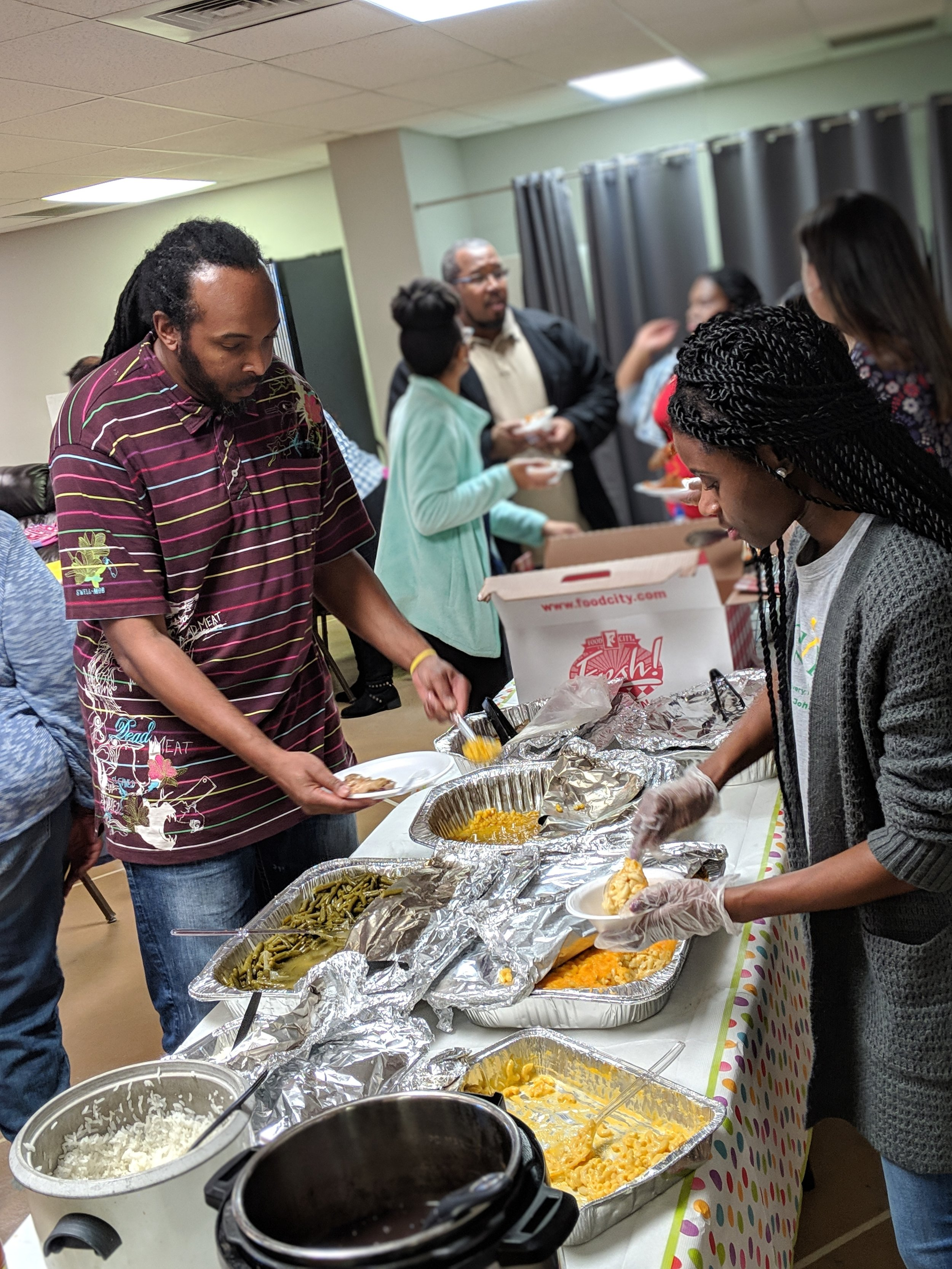 Lonsdale families who are part of Emerald Youth's JustLead Ministry recently gathered for a potluck dinner.