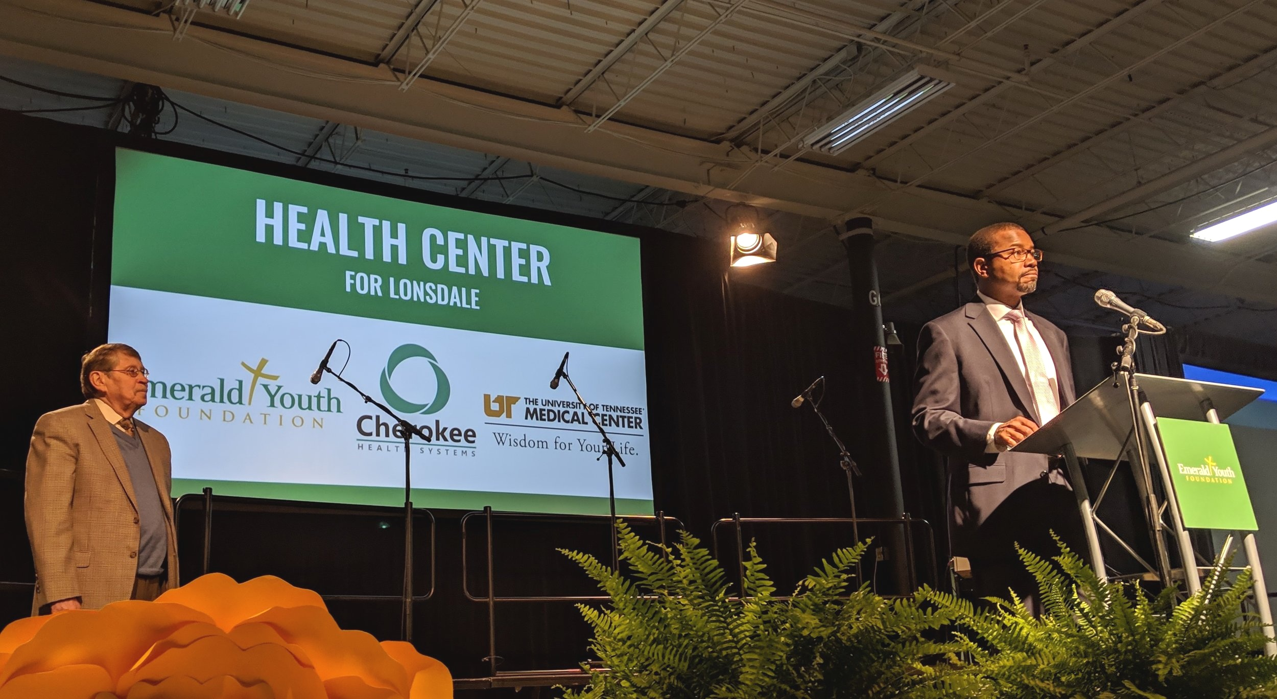 Dr. Keith Gray, senior vice president and chief medical officer of UT Medical Center, announces a collaboration with Emerald Youth Foundation, Cherokee Health Systems and UT Medical Center to open a Health Center in Lonsdale. Dr. Dennis Freeman, CEO of Cherokee Health Systems, looks on.