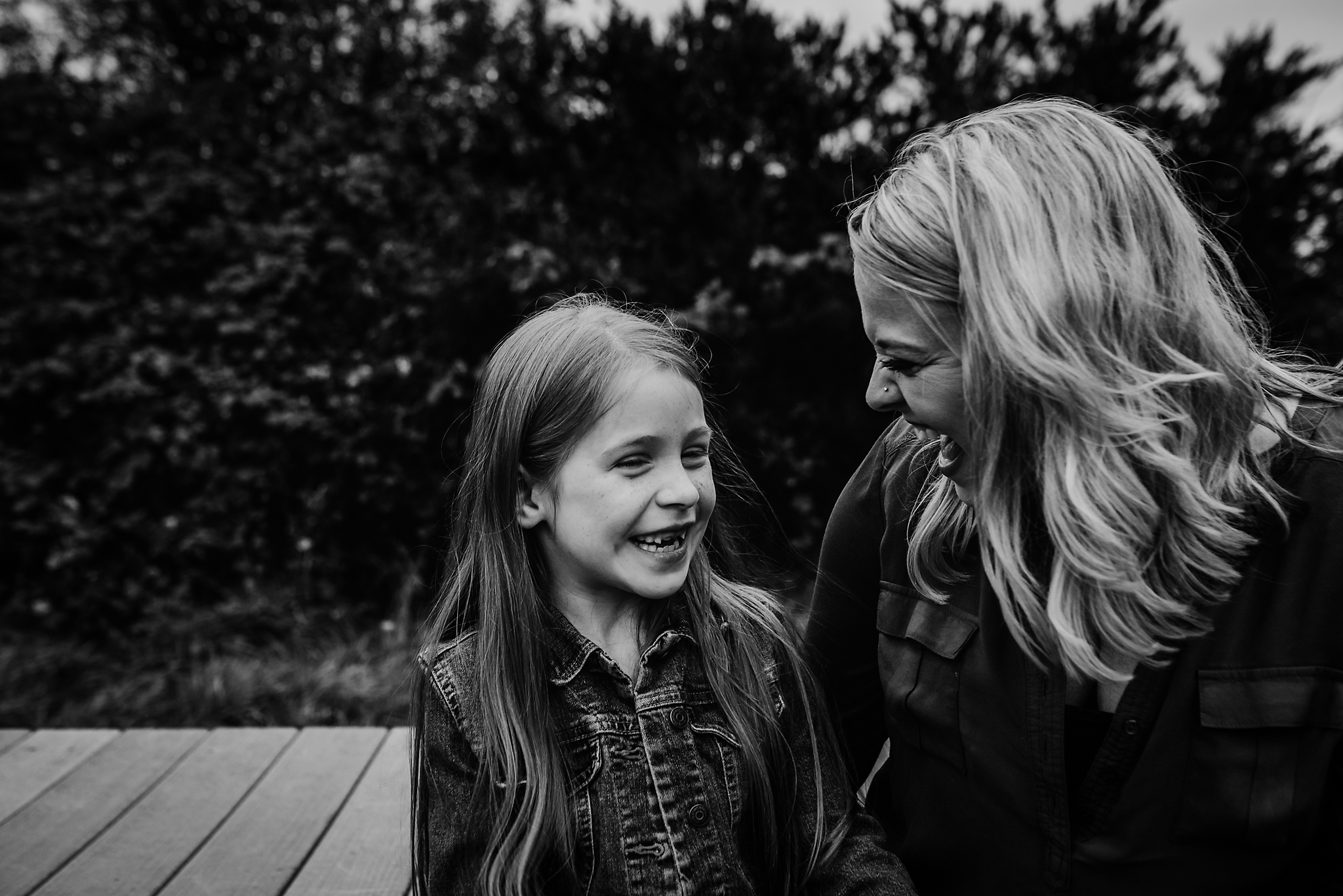 Mom and daughter laughing in Lake Oswego